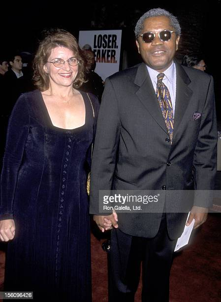 Actor Clarence Williams III and guest attend the 'Bowfinger' Universal City Premiere on August 10 1999 at Universal Amphitheatre in Universal City...