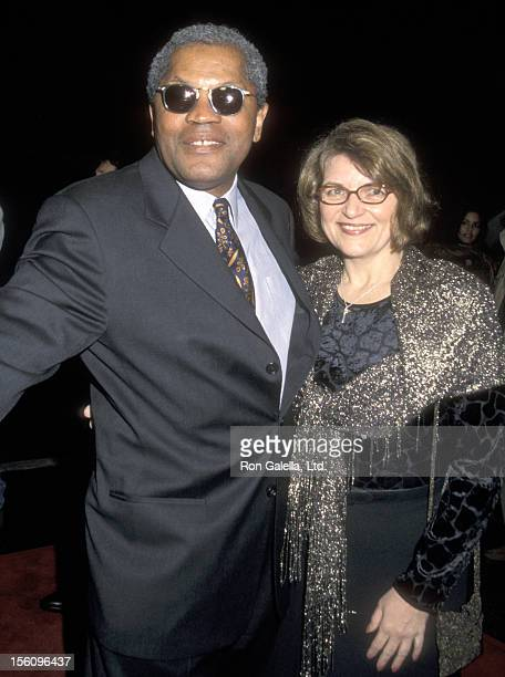 Actor Clarence Williams III and guest attend the 'Reindeer Games' Hollywood Premiere on February 21 2000 at El Capitan Theatre in Hollywood California