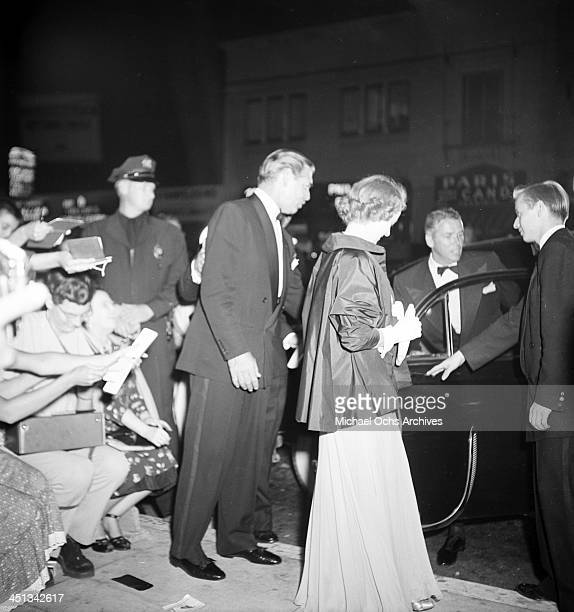 LOS ANGELES JULY17 1951 Actor Clark Gable and guest leaving the premier to 'Showboat' in Los Angeles California