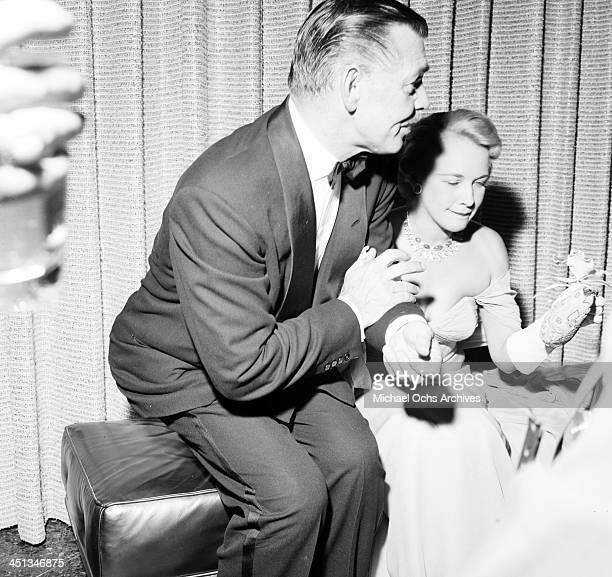 LOS ANGELES AUGUST 91955 Actor Clark Gable and wife Kay Spreckels at a party at the Hilton Hotel in Los Angeles California