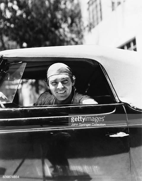 Actor Clark Gable driving throught the gates of MetroGoldwynMeyer Studios