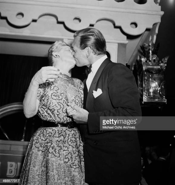 LOS ANGELES JULY17 1951 Actor Clark Gable kisses columnist Hedda Hopper at the premier to 'Showboat' in Los Angeles California