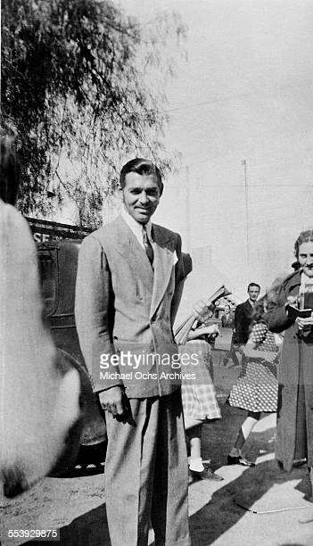 Actor Clark Gable poses on the street in Los Angeles California