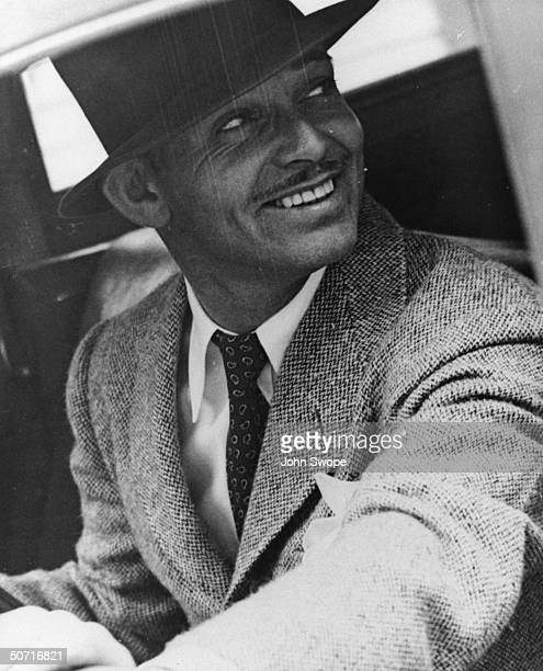 Actor Clark Gable smiling wearing a hat