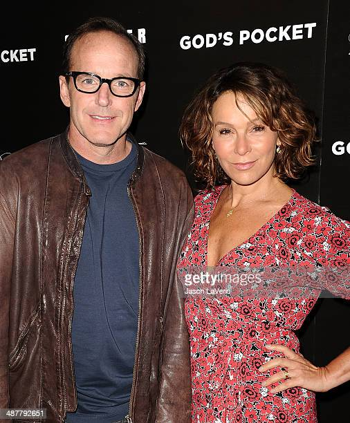 Actor Clark Gregg and actress Jennifer Grey attend the premiere of 'God's Pocket' at LACMA on May 1 2014 in Los Angeles California