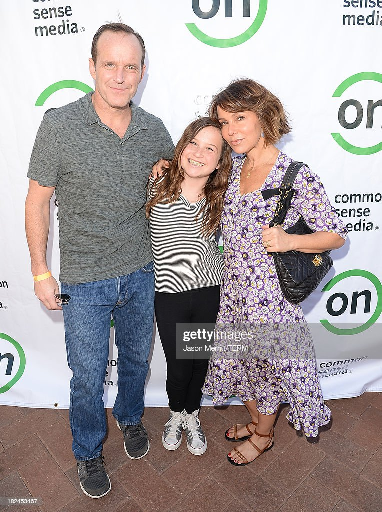 Actor Clark Gregg, daughter Stella Gregg, and actress Jennifer Grey attend the 2nd Annual GameOn! fundraiser hosted by Common Sense Media at Sony Pictures Studios on September 29, 2013 in Culver City, California.