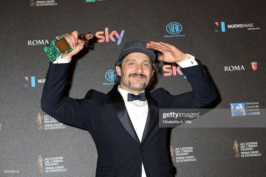 Actor Claudio Santamaria poses with his David di Donatello award for Best Actor at the 60. David di Donatello ceremony on April 18, 2016 in Rome, Italy.