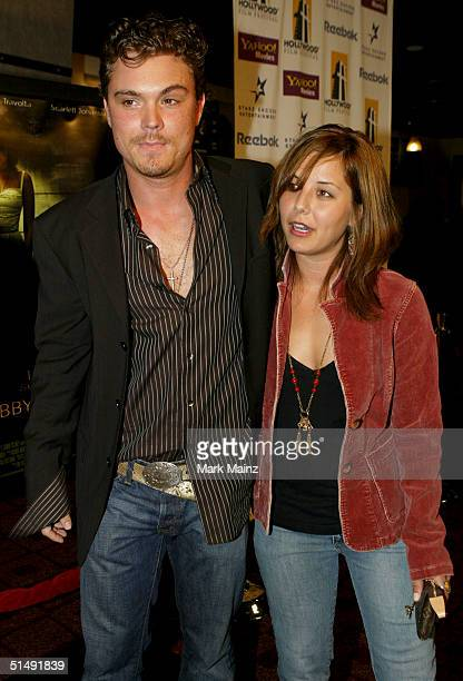 Actor Clayne Crawford and guest attend the Hollywood Film Festival's closing night premiere of 'A Love Song For Bobby Long' at the ArcLight Theatre...