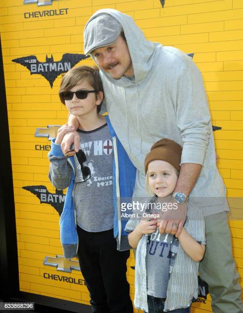Actor Clayne Crawford and sons arrive for the Premiere Of Warner Bros Pictures' 'The LEGO Batman Movie' held at Regency Village Theatre on February 4...