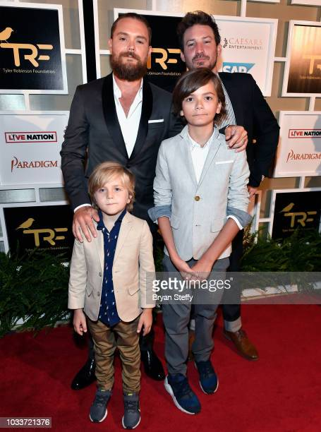 Actor Clayne Crawford his sons Hixon Crawford Colton Crawford and actor Linds Edwards attend Imagine Dragons' fifth annual Tyler Robinson Foundation...