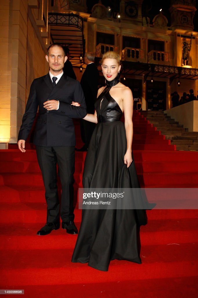 Actor Clemens Schick (L) and actress Amber Heard attend the Montblanc international gala to celebrate the official opening of its new and biggest concept store in the world at the Montblanc Sanlitun Concept Store on June 1, 2012 in Beijing, China.