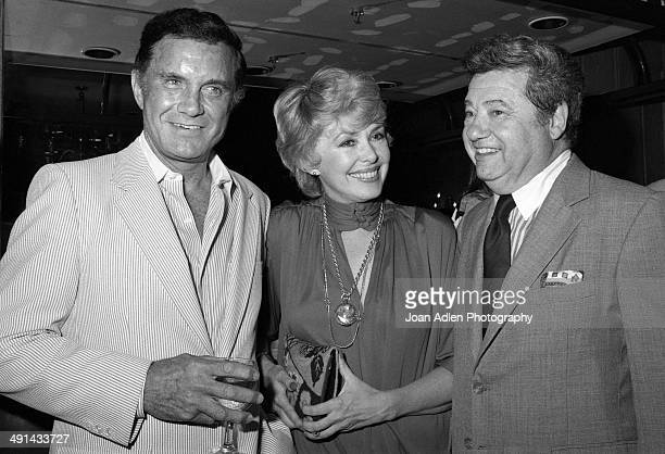 Actor Cliff Robertson with actress Barbara Rush and her husband film industry publisist Warren Cowan at Rowan Martin's Laugh In cast reunion in 1983...