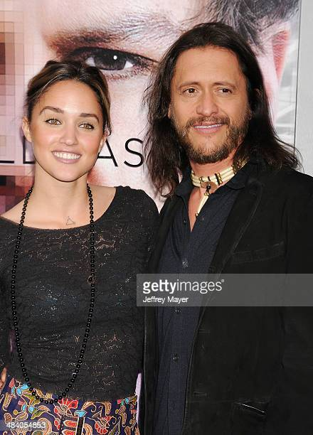 Actor Clifton Collins Jr and wife Megan Ozurovich arrive at the 'Transcendence' Los Angeles Premiere at Regency Village Theatre on April 10 2014 in...