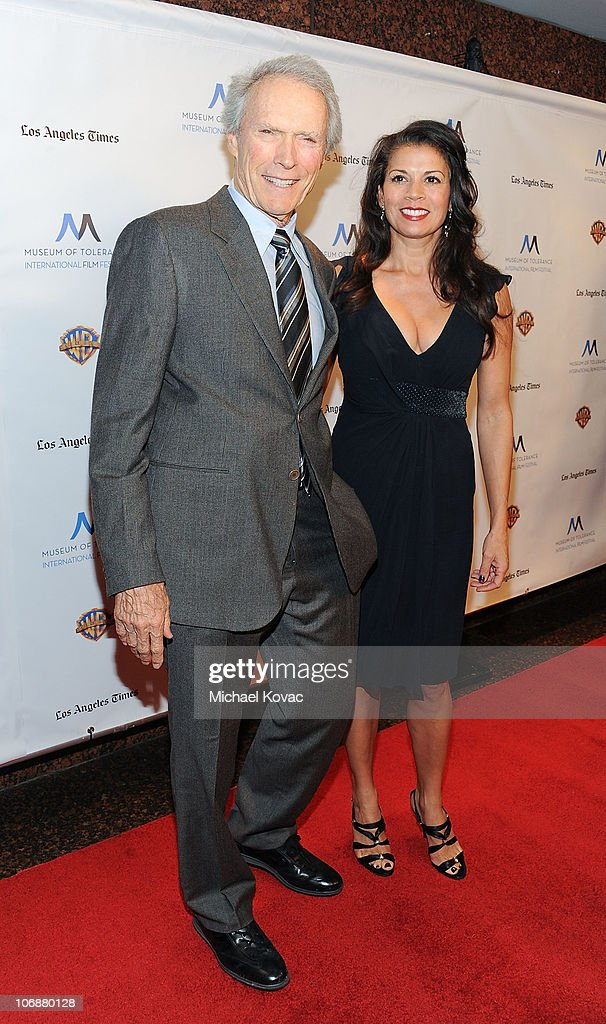 Actor Clint Eastwood (L) and wife Dina Ruiz arrives at the Inaugural Museum Of Tolerance International Film Festival Gala honoring Clint Eastwood at Museum Of Tolerance on November 14, 2010 in Los Angeles, California.