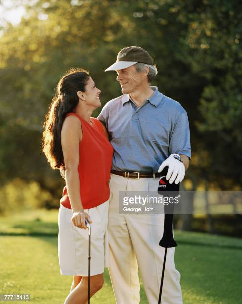 Actor Clint Eastwood and wife/journalist Dina Eastwood are photographed for Golf Digest for Women on March 17 2000 playing golf at Tehama Golf Course...