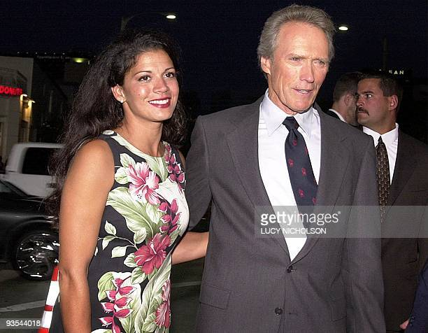 US actor Clint Eastwood arrives at the premiere of his new film Space Cowboys with his wife Deena in Los Angeles 1 August 2000 Eastwood directed and...