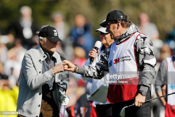Actor Clint Eastwood celebrates with Sir Nick Faldo after playing his shot from the 17th tee during the 3M Celebrity Challenge prior to the ATT...