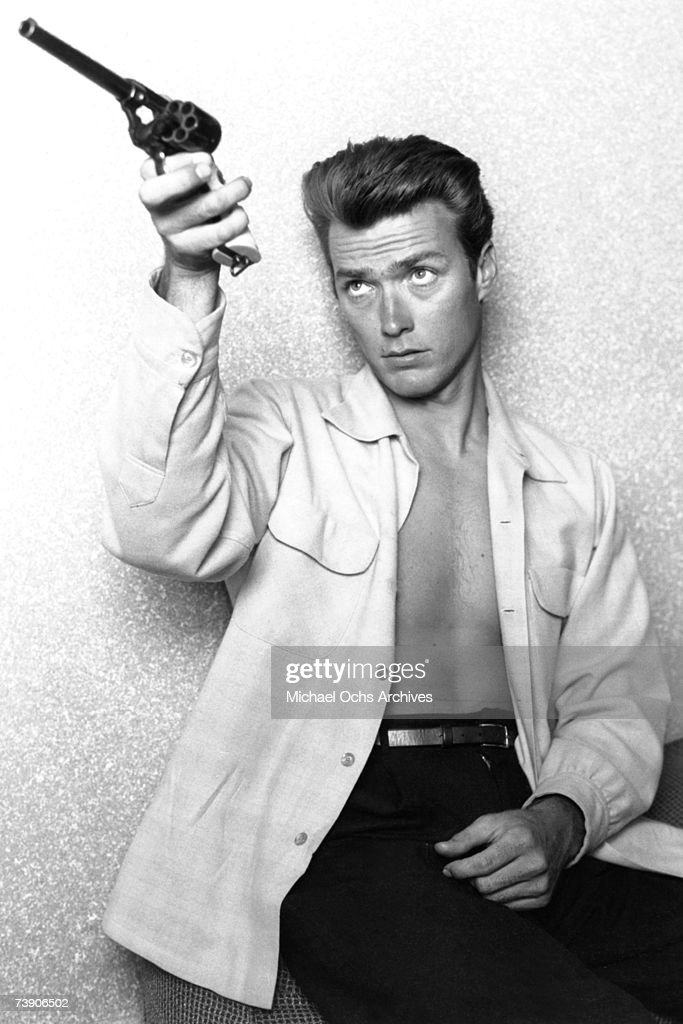 Actor Clint Eastwood checks his gun at home on June 1, 1956 in Los Angeles, California.