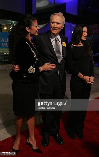 Actor Clint Eastwood his wife Dina Eastwood and Patti Davis daughter of former US president Ronald Reagan arrive at the induction ceremony for the...
