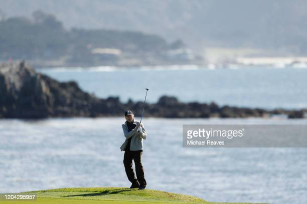 Actor Clint Eastwood plays a shot on the 18th hole during the 3M Celebrity Challenge prior to the ATT Pebble Beach ProAm at Pebble Beach Golf Links...