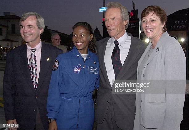 US actor Clint Eastwood poses with NASA advisors Dr Peach Yvonne Gagle Catherine Clarke as he arrives at the premiere of his new film Space Cowboys...