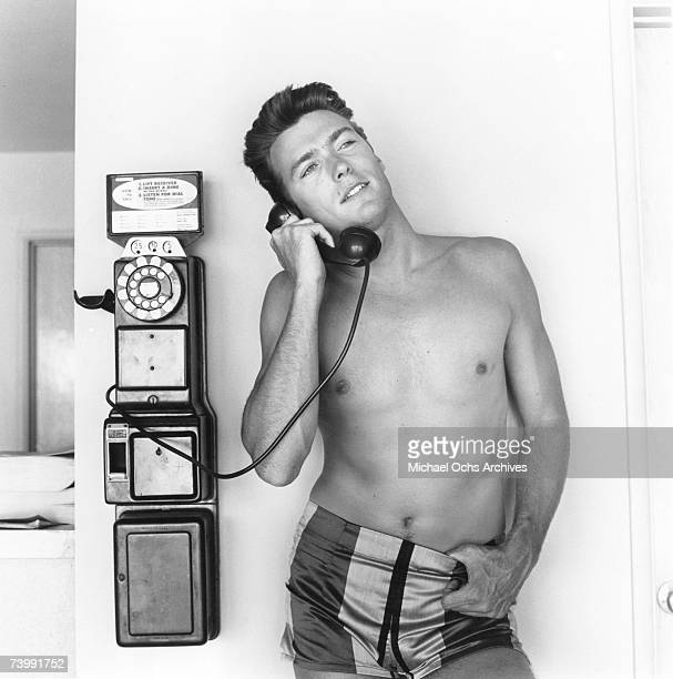 Actor Clint Eastwood talks on a pay phone outside his home on June 1 1956 in Los Angeles California