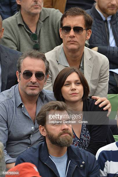 Actor Clive Owen actor Jean Dujardin Nathalie Pechalat and actor Clovis Cornillac attend the French Tennis Open Day Fifteen with the Final between...