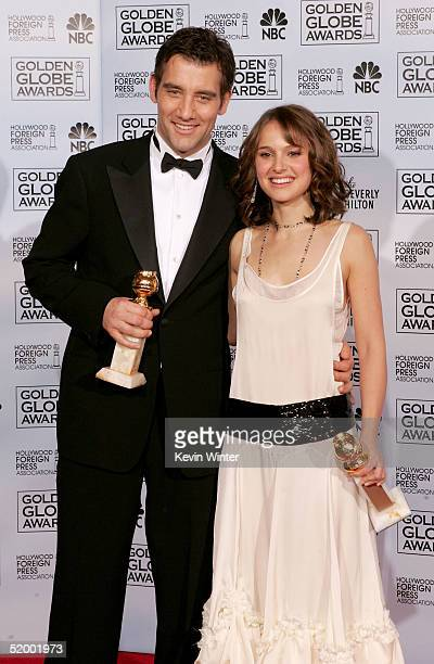 Actor Clive Owen and actress Natalie Portman pose with their awards for Best Performance by an Actor and Actress in a Supporting Role in a Motion...