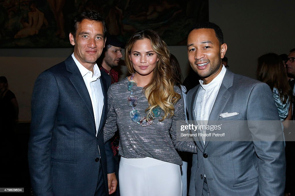 Actor Clive Owen (L), Singer John Legend (R) and his wife Model Chrissy Teigen (C) attend the Giorgio Armani Prive show as part of Paris Fashion Week Haute-Couture Fall/Winter 2015/2016. Held at Palais de Chaillot on July 7, 2015 in Paris, France.