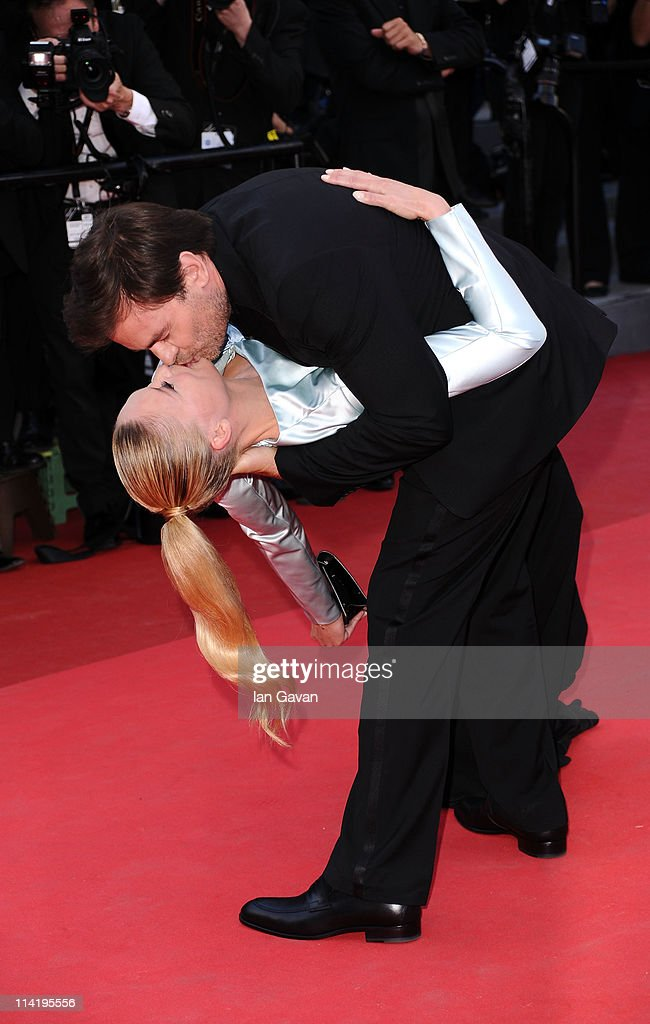 Actor Clovis Cornillac (R) and Lilou Fogli attend 'The Artist' premiere at the Palais des Festivals during the 64th Annual Cannes Film Festival on May 15, 2011 in Cannes, France.