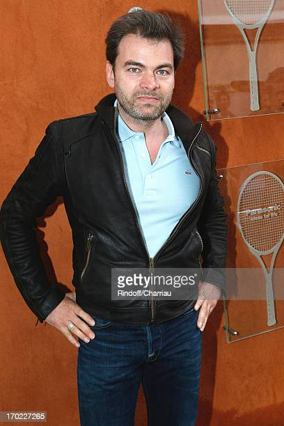 Actor Clovis Cornillac attends the Roland Garros Tennis French Open 2013 Day 15 on June 9 2013 in Paris France
