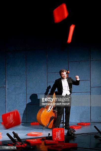 Actor Clovis Cornillac during the traditional throw of cushions at the final of 'La Contrebasse' play at 29th Ramatuelle Festival Day 9 on August 8...