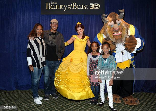 Actor Coby Bell Aviss PinkneyBell and daughters Serrae Bell and Jaena Bell pose with Belle and the Beast at a Special Screening of Beauty and the...