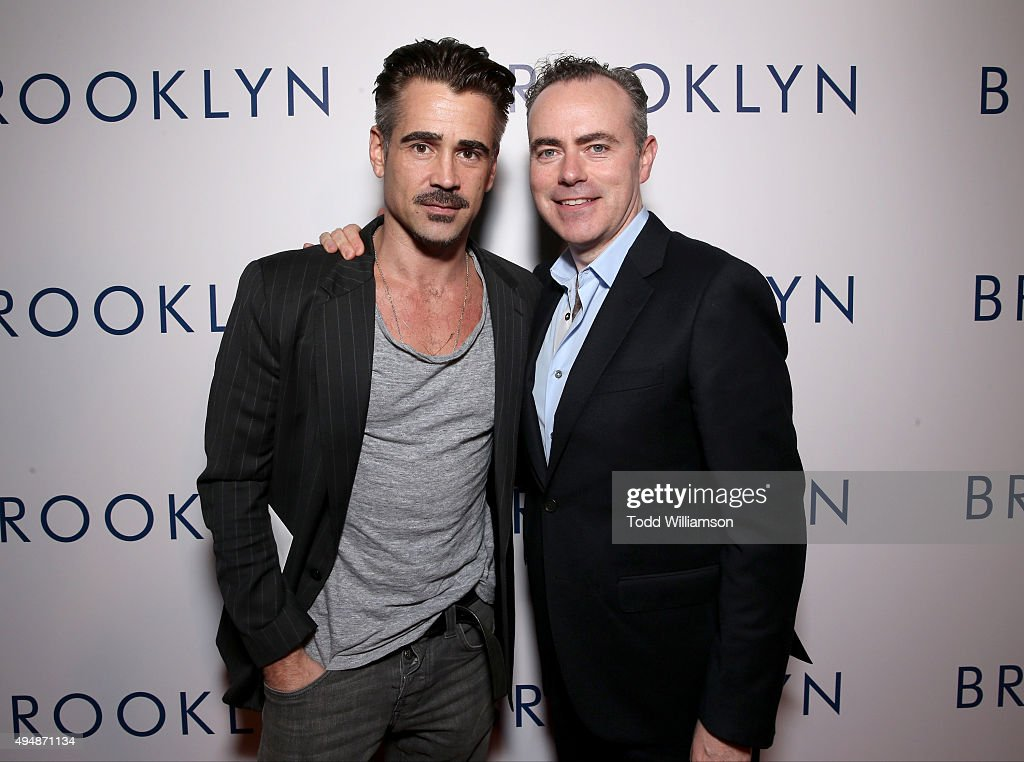 Actor Colin Farrell (L) and director John Crowley arrive at the Los Angeles premiere of Fox Searchlight's 'Brooklyn' at the Harmony Gold Theatre on October 29, 2015 in Los Angeles, California.