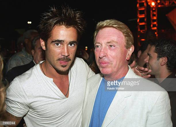 Actor Colin Farrell and Phone Booth writer Larry Cohen pose at the afterparty for SWAT on July 30 2003 in Los Angeles California