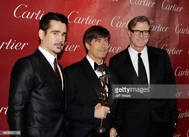 Actor Colin Farrell composer Thomas Newman and writer/director John Lee Hancock pose with the Frederick Loewe Award for Film Composing for Saving Mr...