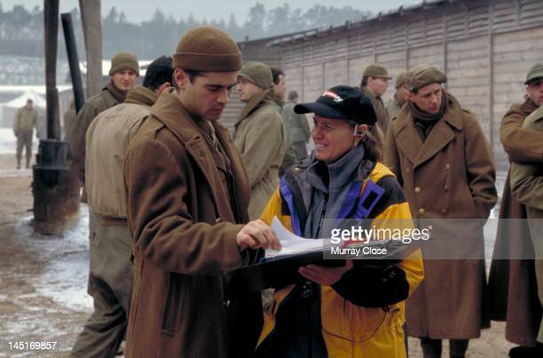 Actor Colin Farrell consults the shooting script on the set of the film 'Hart's War' 2002