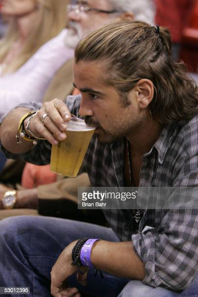 Actor Colin Farrell drinks a beer as he watches Game Five of the Eastern Conference Finals between the Detroit Pistons and the Miami Heat during the...