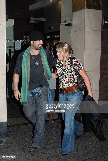 Actor Colin Farrell leaves with a mystery woman after a 'Tassel Club' burlesque and cabaret club performance at The Sugar Club on December 13 2006 in...