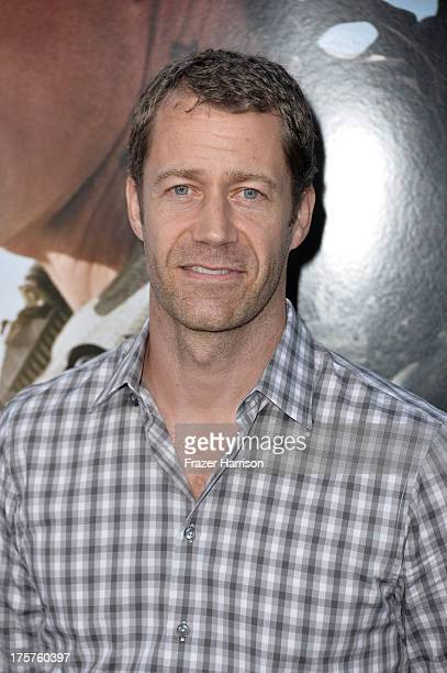 Actor Colin Ferguson arrives at the premiere of TriStar Pictures' Elysium at Regency Village Theatre on August 7 2013 in Westwood California