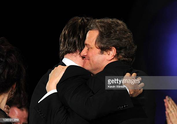 Actor Colin Firth hugs Director Tom Hooper just as he's about to accept the Outstanding Directorial Achievement in Feature Film for 2010 award for...