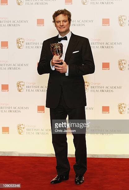 Actor Colin Firth poses with the award for Leading Actor in the film 'The King's Speech' during the Orange British Academy Film Awards at The Royal...