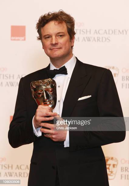 Actor Colin Firth poses with the for Leading Actor for the film 'The King's Speech' during the Orange British Academy Film Awards at The Royal Opera...