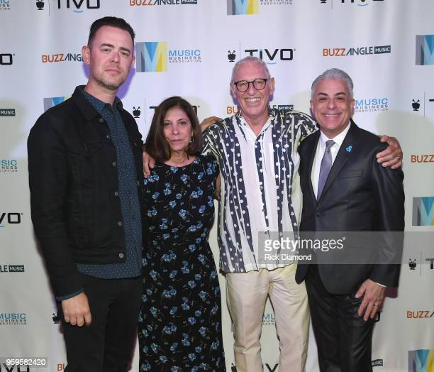 Actor Colin Hanks Patti Solomon Michael Solomon and President of Music Business Association James Donio take photos before the Music Biz 2018 Awards...