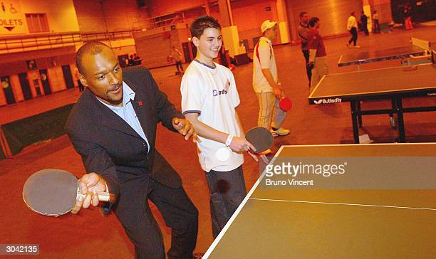 Actor Colin Salmon joins in a table tennis workshop with Glen Churches at the Prince's Trust xl Celebration Day on March 4, 2004 in Wembley, London....