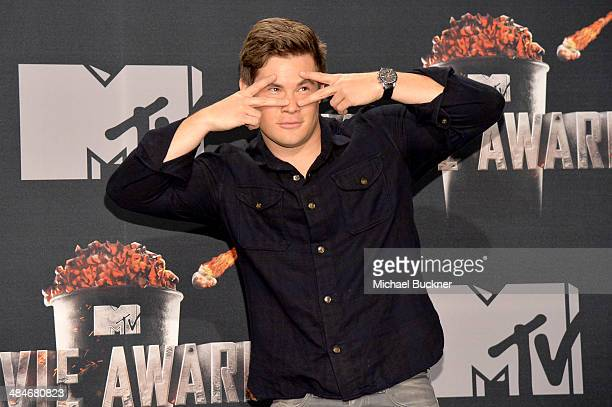 Actor/ comedian Adam DeVine poses in the press room during the 2014 MTV Movie Awards at Nokia Theatre LA Live on April 13 2014 in Los Angeles...