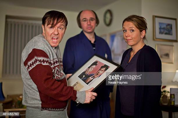 Actor comedian and director Ricky Gervais with cast members Karl Pilkington and Kerry Godliman are photographed on set of the comedy drama Derek in...
