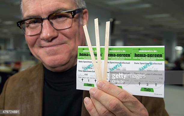 Actor comedian and star of Little Mosque on the Prairie Neil Crone holds up a colorectal cancer screening kit that people can use at home then mail...
