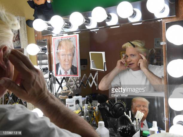 Actor comedian and writer John Di Domenico is reflected in a mirror as he puts on a wig as he gets ready to record videos for the Cameo personalized...