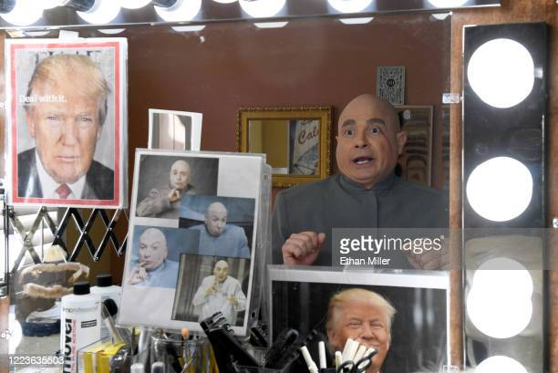 Actor comedian and writer John Di Domenico is reflected in a mirror as he changes from US president Donald Trump into the Dr Evil character from the...